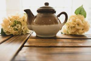 Ceramic brown teapot on a wooden surface