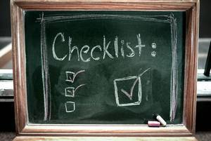 Checklist written on a chalkboard