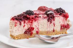 Cheesecake with Blackberries slice on the plate