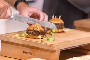 Chef cutting a hamburger
