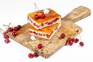 Cherry pie slices on a wooden kitchen Board with fresh cherries (Flip 2020)