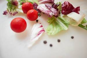 Cherry tomatoes and fresh letuce close up