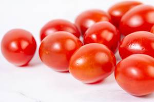Cherry Tomatoes on the kitchen marble table (Flip 2019)
