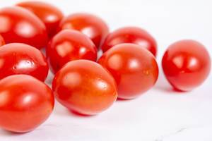 Cherry Tomatoes on the kitchen marble table