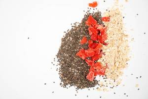 Chia Seeds, Dried Papaya and Oatmeal with copy space