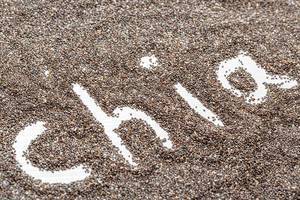 Chia word made on chia seeds background