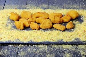 Chicken nuggets on black background
