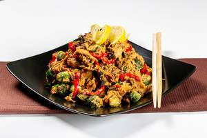 Chicken with vegetables in spicy sauce
