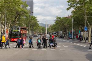 Children crossing the street in the city centre of Barcelona