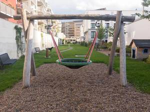 Children Playground in Residential Area with Basket Swing