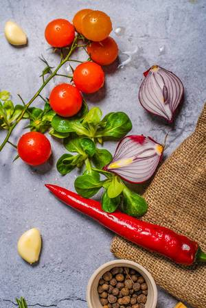 Chilli pepper and veggies on background (Flip 2019)