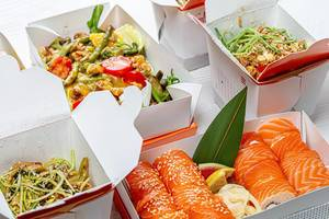 Chinese food in cardboard boxes-salad, sushi, noodles, rice (Flip 2019)