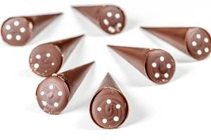 Chocolate candies in the shape of a cone on a white background (Flip 2020)