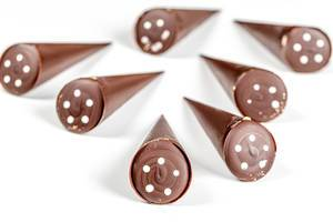 Chocolate candies in the shape of a cone on a white background