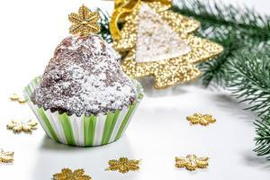 Chocolate cupcake on christmas background