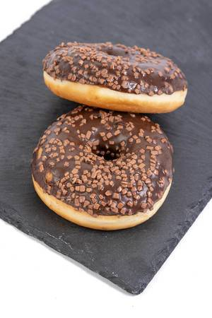 Chocolate Donuts on the black stone tray