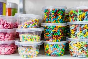 Chocolate filled candies on small containers