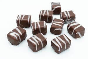 Chocolate Pralines on the white background (Flip 2019)
