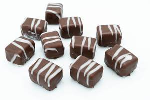Chocolate Pralines on the white background