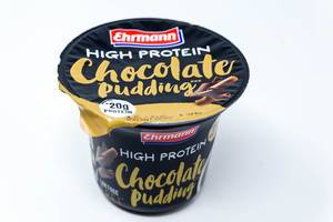 Chocolate Pudding with High Proteins by Ehrmann in black and golden packaging