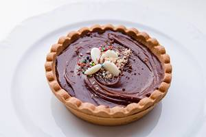 Chocolate tart and colorful sprinkles