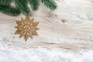 Christmas background with Christmas tree branches, snow and golden snowflake (Flip 2019)