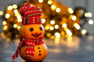 Christmas background with tangerine snowman