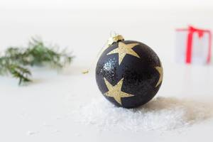 Christmas ball on snow