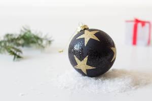Christmas ball on snow