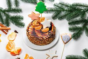 Christmas cake with gingerbread and tangerines on New year background (Flip 2019)