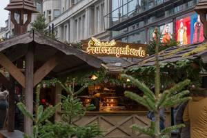 Christmas market stall sells Feuerzangenbowle, a traditional Christmas drink with hot rum