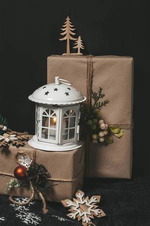 Christmas night background with gifts and lantern