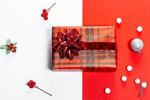 Christmas red and white background with Packed gift. Top view