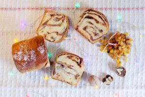 Christmas sponge cake with raisins and nuts