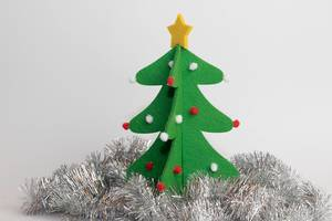 Christmas tree form felt surrounded by silver tinsel