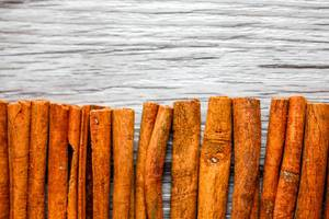 Cinnamon Stick on a Wooden Baclground