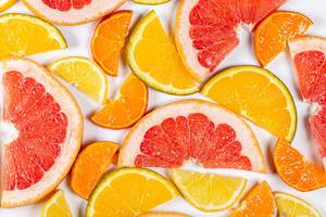 Citrus background with slices of juicy fresh fruit, top view (Flip 2020)