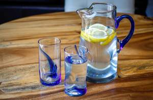 Citrus Water in a Pitcher with Glasses.
