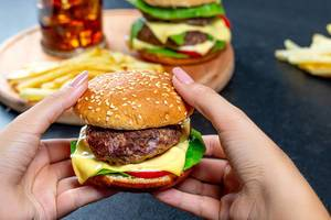 Classic Burger with cutlet and cheese in hand