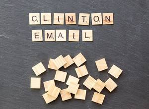 Clinton Email as a recent news topic set of wooden tiles