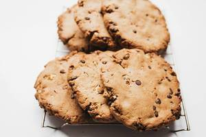Close of of big chocolate cookies on white background.