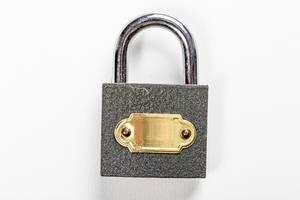Close padlock on white background (Flip 2019)