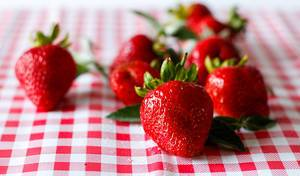 Close Up Bokeh Photo of Washed Strawberries on Kitchen Cloth