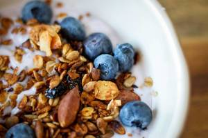 Close up Food Photo of a Muesli Bowl with Blueberries, Almond and Yogurt