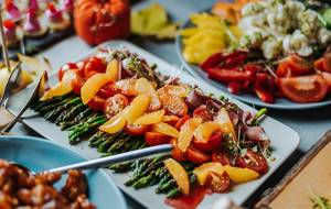 Close Up Food Photo of Asparagus with Tangerines and Tomatoes