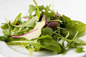 Close Up Food Photo of Fresh Mixed Lettuce Salad and Field Greens on White Background