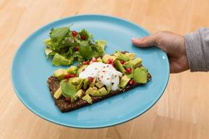 Close Up Food Photo of Healthy Wholemeal Bread with Avocado, Basil and Pomegranate