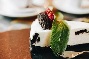 Close Up Food Photo of Oreo Cake Dessert with Strawberry and Cookie