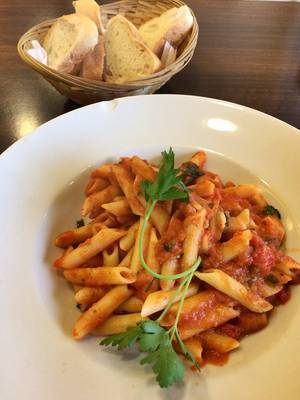 Close Up Food Photo of Penne Arrabiata Spicy Pasta with Tomato Sauce and Bread