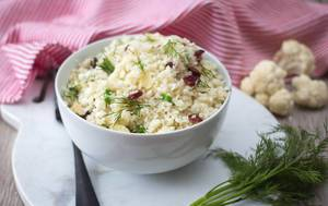 Close Up Food Photo of Rice with Cauliflower, Almonds and Cranberries in a White Bowl